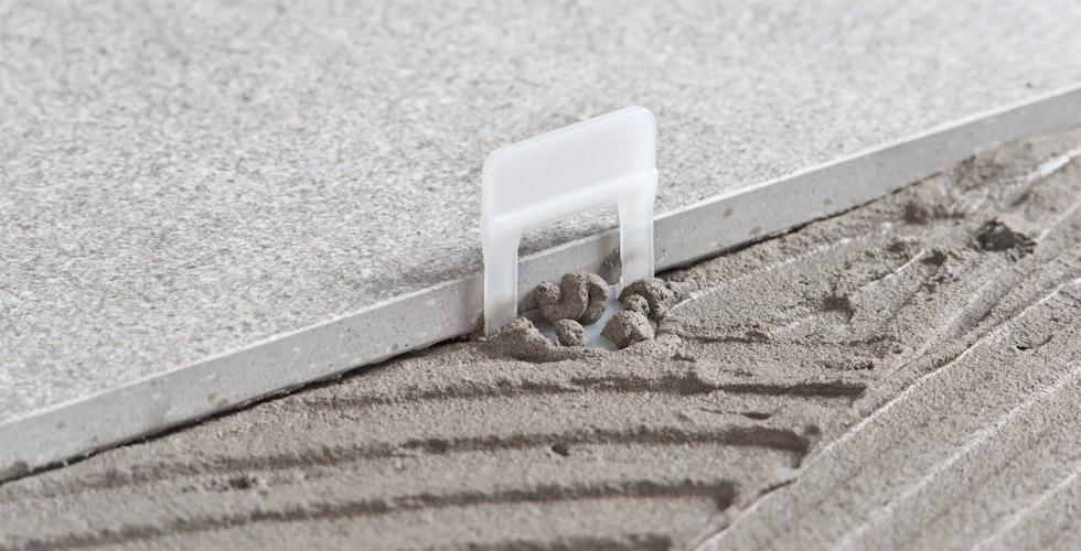 Distanziatori livellanti a accessori per pavimenti e piastrelle